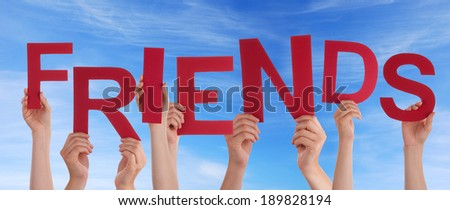 Many Hands Holding the Red Word Friends in the Sky - stock photo