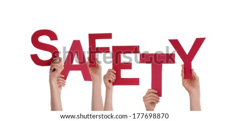 Many Hands Holding the Red Word Safety, Isolated - stock photo
