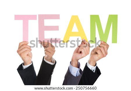 Many Hands Holding The Word Team Over White Background - stock photo
