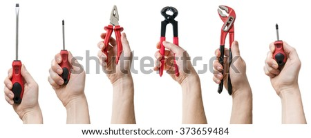 Many hands holds up instruments and tools. Isolated on white background. Maintenance concept. - stock photo