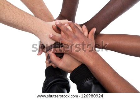 Many Hands Lying On Top Of Each Other On White Background - stock photo