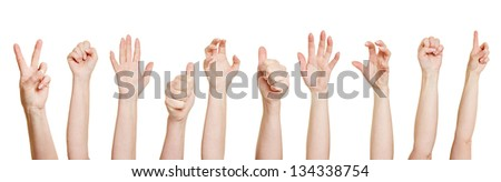 Many hands making different gestures like fists or thumbs up - stock photo