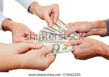 Many hands of senior people holding dollar money bills - stock photo