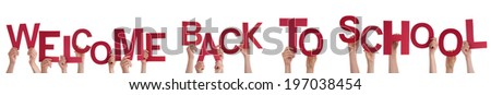 Many Hands or Children Holding the Words Welcome Back To School, Isolated - stock photo