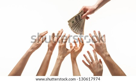 Many hands reaching out for money, white background - stock photo