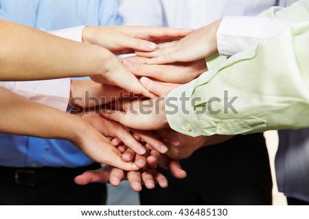 Many hands stacked for motivation in a group of business people