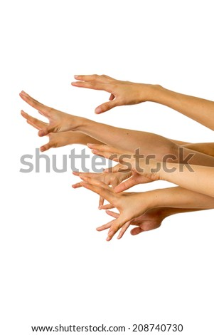 many hands trying to reach and catch something - stock photo