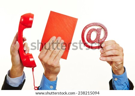 Many hands with phone and mail as communication concept - stock photo