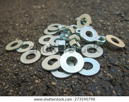 Many hardwares such as bolts, nuts and screws at the construction site. - stock photo