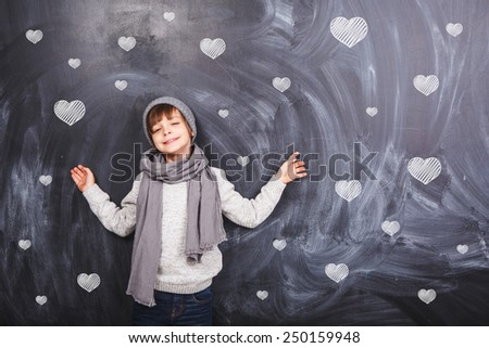 Many hearts and a boy on a gray background - stock photo