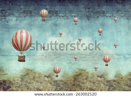 Many hot air balloons flying over a forest  - stock photo
