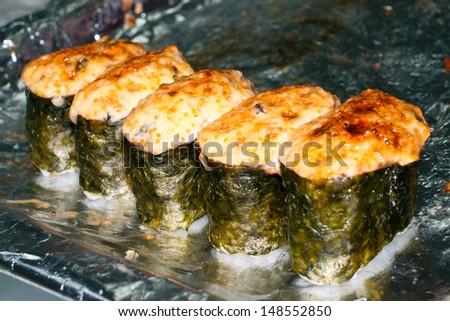 Many hot sushi rolls. Shallow DOF - stock photo