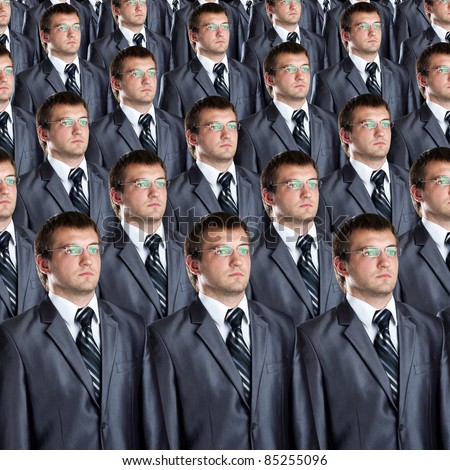 Many identical businessmen clones. Businessman production concept - stock photo