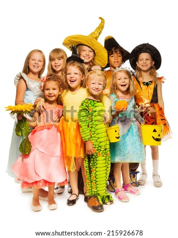 Many kids stand in Halloween costumes together - stock photo