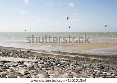 Many kite surfers on the water of Brouwersdam in Zeeland - stock photo