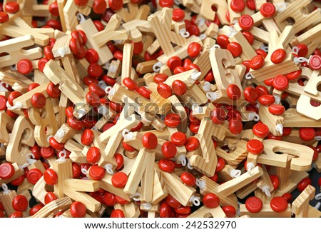 many letters in wood with Red wheels to compose words and name of children - stock photo