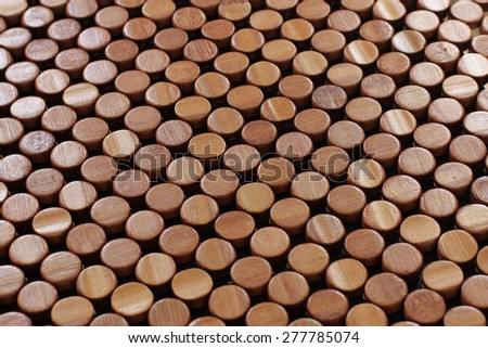 many lines of lovely wooden round buttons - stock photo