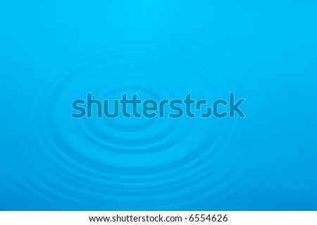 many little water waves on silent water-surface