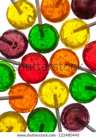 Many lollipops, assorted colors, close-up - stock photo