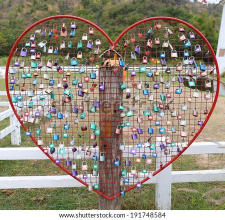 Many Love locks - a symbol of eternal love, friendship and romance. - stock photo