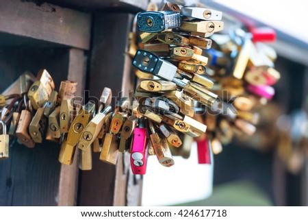 Many love locks on the bridge in Venice - stock photo