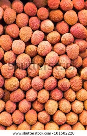 Many lychees at a market stall. - stock photo