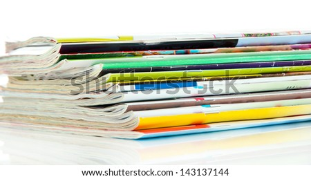 Many magazines isolated on white