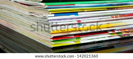 Many magazines on dark background - stock photo