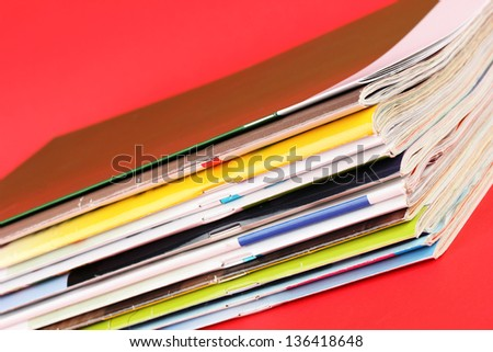 Many magazines on red background