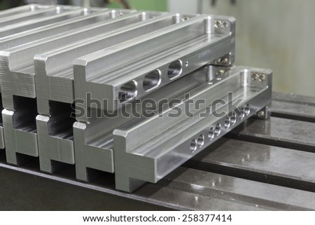 many manufacture stainless steel array on steel table - stock photo