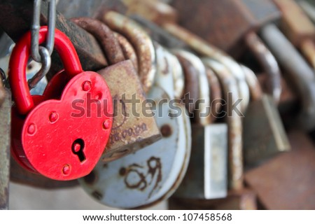 Many marriage love symbol padlocks chained on bridge - stock photo