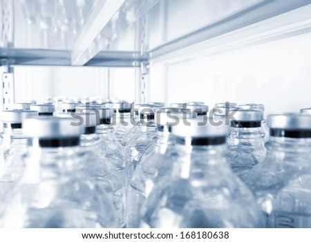 many medical vials in a storage shelf - stock photo
