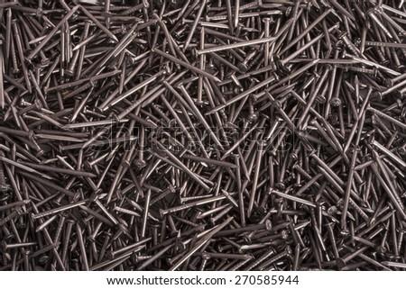 many metal nails close up macro isolated - stock photo