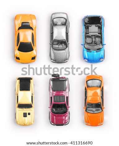 Many multi-colored toy cars on white background - stock photo