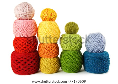 many multicolored clews in a vertical rows, isolated - stock photo