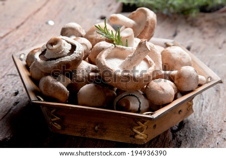 Many mushrooms in wooden basket