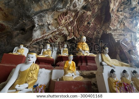 Many of Buddha Images and Hundreds of rock carvings of Buddha Image on limestone at Kaw-goon ancient cave in Kaw-goon Village, Hpa-an, Kayin State, Myanmar. - stock photo