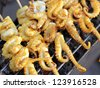 Many of grilled squid in thai market - stock photo