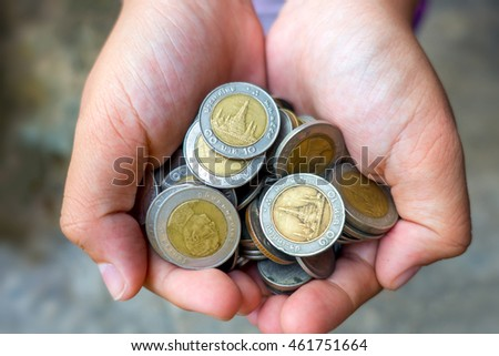 Many of Thai Baht Coins in hand.