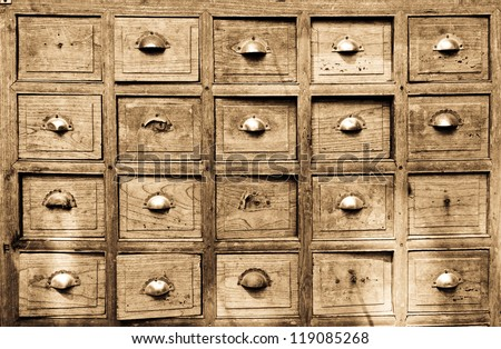 Many of the ancient wooden drawers background - stock photo