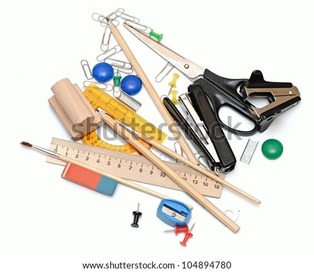 Many office tools on a white background - stock photo