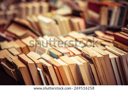 Many old books in a book shop or library. Shallow DOF - stock photo