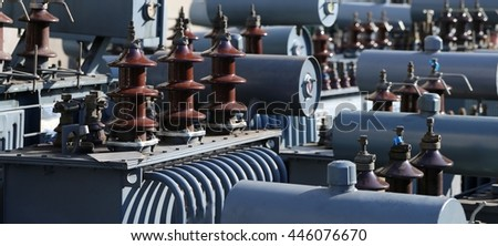 many old large electric voltage transformers in the dump of the eco-center authorized