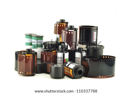 many old photo film rolls over white background - stock photo