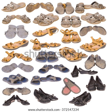 Many old, well-used running shoes and boots, all logos and brand markings removed, isolated on white. - stock photo