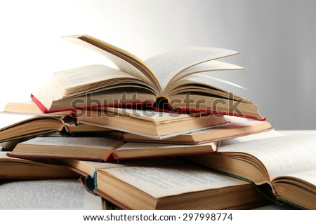 Many open books isolated on white - stock photo