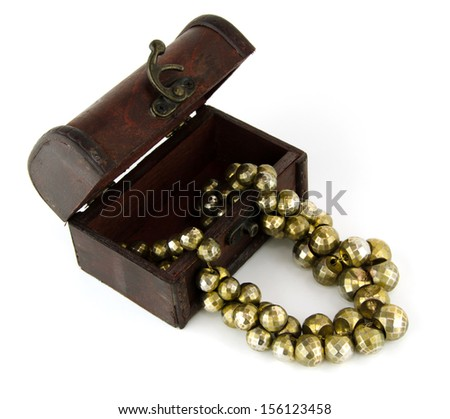 Many ornaments, stone, semi-precious,amethyst,aquamarine, green, blue, and gold-plated metal, a different look so I placed the overflow out of the box, vintage red wooden door on white background.  - stock photo