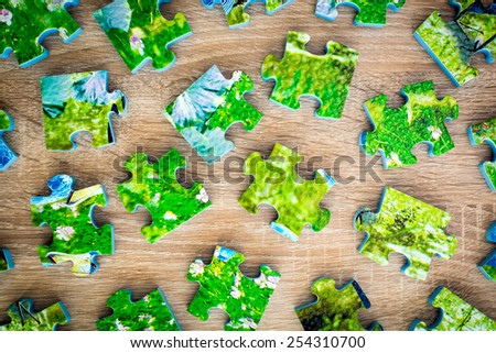 Many parts of a disassembled jigsaw puzzle  - stock photo