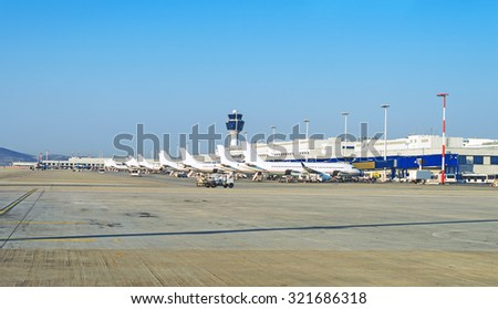 Many passenger planes in the airport.  - stock photo