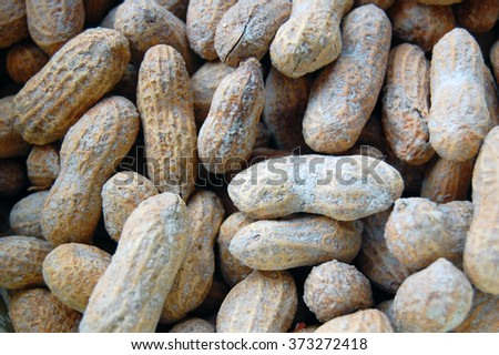 Many peanuts in shells, one upon the other - stock photo